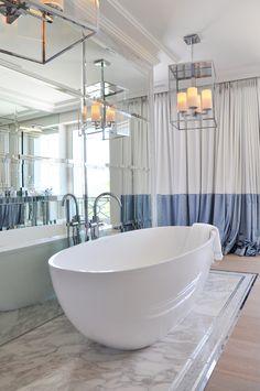 Contemporary bathroom in mirror and marble