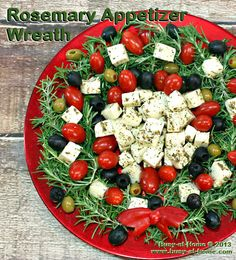 This beautiful Rosemary Christmas Wreath Appetizer tray is chockful of veggies, olives and cheese - enough to feed a much bigger crowd. Get creative and use your favorites to decorate the wreath!