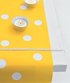 Cupcake Liner Votive Holders  Set the mood with a litter of votive candles in inexpensive foil cupcake liners - so cute!  Photo from Real Simple.