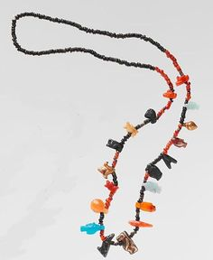 "Necklace with disc beads and amulets 18th Dynasty, New Kingdom, Egypt c.1550-1425 BC This necklace is composed of tiny disk beads interspersed with a variety of amulets, including falcons, a frog, Tawerets, a lotus, bolti fish, a shell or bullae, a hand, and a ""nefer"" sign. Some amulets, such as the lotus, frog, and fish, symbolize fertility, while Taweret and the falcon offer protection. The ""nefer"" hieroglyph conveys a good wish. This necklace was one of three ..."