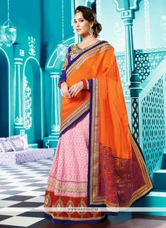 Lisa haydon pink and orange georgette lehenga saree is showing innovative patterns done with embroidery, sequins, stone, zari, lace and patch border work. As shown matching blouse available with us. (...