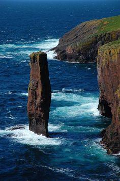 Isle of Papa Stour sea stacks and deep blue water, Scotland.