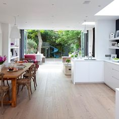 Bi-fold doors and u-shaped kitchen with dining table. This is similar to the shape of our new kitchen/diner (I hope! Kitchen Living, New Kitchen, Kitchen Decor, Kitchen Ideas, Kitchen Layouts, Kitchen Family Rooms, Summer Kitchen, Kitchen White, Kitchen Diner Extension