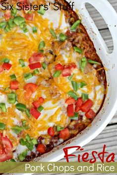 Fiesta Pork Chop and Rice Bake from SixSistersStuff.com. An easy Mexican-type dish your family will love! (Could substitute chicken)