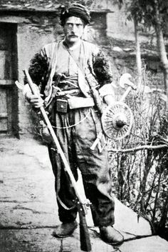 A fully armed Armenian mountain dweller. From the region between Van en Hakkari. Late-Ottoman era, end of the 19th century. Shown with rifle, axe and Ottoman type kalkan shield.