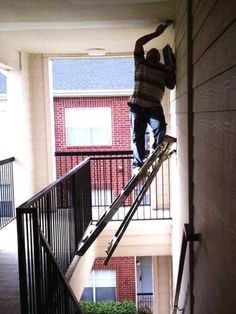 This Is One Way To Use A Ladder To Pain The Wall Above A Staircase.