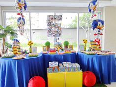 Sonic birthday party color scheme.  Love the photo number on the glass too, great idea!