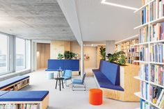 KINZO realized the book-infused office design for publishing company, Suhrkamp Verlag, located in Berlin, Germany. It was a long journey for Suhrkamp's Design Studio Office, Office Interior Design, Office Interiors, The Door Is Open, Luxury Office, Built In Furniture, Grey Table, Open Office, Maximize Space