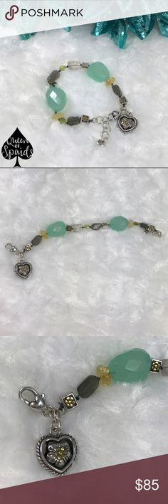 Brighton Multi Tone Silver & Gold Stone Bracelet This Brighton multi tone gemstone retired bracelet is truly gorgeous and one-of-a-kind! I have not seen any others like it and it used to belong to my mother so I do not know when she purchased it probably sometime around 2007 to 2011. The bracelet measures 7 inches long and has about a 1 inch extension. Has a silver and gold heart with a flower in the middle charm near the lobster clasp part of the bracelet.  ♠️No Trades ♠️No Off Posh…