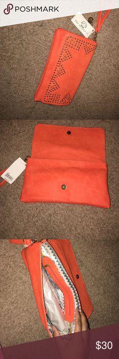 Big Buddha Orange clutch Never used! Big Buddha orange clutch Big Buddha Bags Clutches & Wristlets