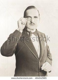 Man peering through monocle