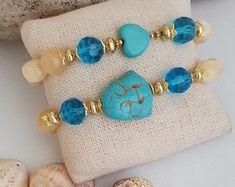 #kayojewelryco #etsyjewelry #fashiondesign #fashionhandmadejewelry #buddhahead #gemstonebracelets #buddha #gemstonecracelet #Turquoisejewelry #buddhajewelry #jewelry2021 #summertrends2021 #bohojewelry2021 #giftideas #daintybraclets #stackable #stonebracelet #yogastacking #handmadebracelet #beadedbraclets2021 #malabracelet #opabracelet