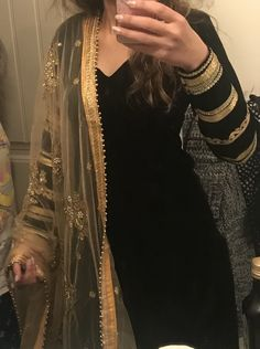 Elegant punjabi suit in black velvet with golden laces on arms and golden embroidered dupatta. Simple Pakistani Dresses, Pakistani Outfits, Indian Outfits, Indian Dresses, Kurta Designs Women, Salwar Designs, Blouse Designs, Indian Attire, Indian Wear