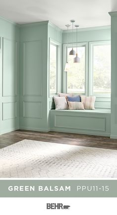 Traditional paneled walls get a modern twist thanks to a new coat of Behr Paint in Green Balsam. This light hue is the perfect addition to this space, reflecting the natural light and creating a calm, tranquil environment. Click below for full color details.