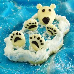 """Sugar cookie decorated to look like a polar bear floating in the deep blue sea."" Cute!"