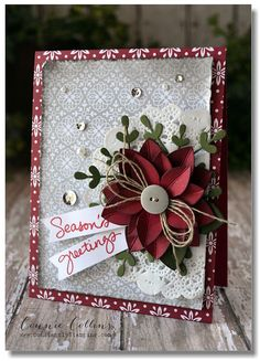 Cherry Cobbler Trim the Tree DSP stack and layered under Smoky Slate from All Is Calm Specialty DSP. The poinsettias are die cut from Cherry Cobbler cardstock with two different size flowers from the Flower Frenzy Bigz L die (#133728). Score each flower from the tips to the center to give the look of veins. The fun greenery behind the flower is actually two snowflakes die cut with the Snowflake Card Thinlits dies, then folded in half on a bit of a diagonal so they have a more random look