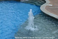 We love to have water features everywhere this is a fun one on the sun ledge! A Hybrid Swimming Pool by Legendary Escapes Ask the Pool Guy, Michigan