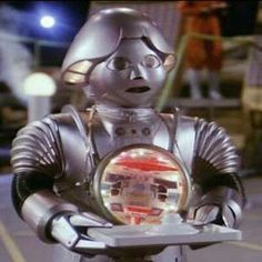 Twiki and Dr.Theopolis from the Buck Rogers television series of the 1980s. NBC tv and Universal television.
