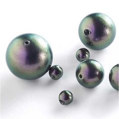 Have you seen the NEW #Swarovski #Pearl? It's perfection in purple. The Crystal Iridescent Purple pearl shows off this two-tone purply-green effect. Soooo pretty--totally worth a double take!