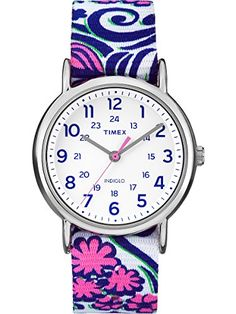 Timex Weekender Reversible Floral Watch - Blue Swirl  Watch  Reversible slip through strap: solid color on one side, polka dot pattern on reverse side  Features 24 hour military time  Water resistant up to 30 meters  Buckle close