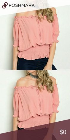 COMING SOON Beautiful Blush Off The Shoulder Top. 100% Rayon. Front tie yoke. Smocked sleeves and waist. Ruffle detail. Made in the USA. Tops