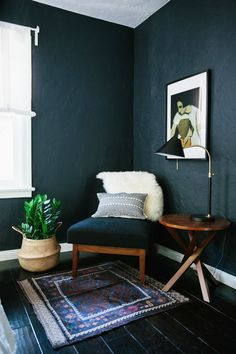 Reading corner in bedroom, beautiful dark matte walls.