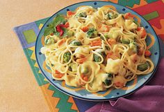 Ready in a snap, the whole family will love this luscious pasta and veggie dish. Using cream of chicken soup and a frozen vegetable combinationmakes it especially easy for the cook.