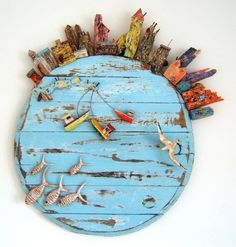 This looks like the top of a cheese box !! Tony Britnell - Round harbour, five fish bird panel