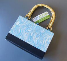 Handmade, one-of-kind purse using a recycled hardcover book, what a SMart idea!    These wonderful little Book Purses are what I like to call