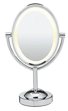 Be sensible. Be distinguished. Be flawless with the Conair Oval Double-Sided Lighted Makeup Mirror, Polished Chrome Finish. This classic beauty mirror features