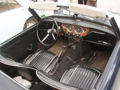 Triumph Spitfire MK3 1967. One of the great little features of this car was the racing type handbrake. No ratchet. Just pull up and then press button to lock on.