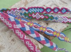 friendship bracelets. How do you make the 3rd one in the middle? PLEASE COMMENT IF YOU KNOW OR HAVE A WEBSITE!! Even a name!!