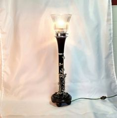 Hey, I found this really awesome Etsy listing at https://www.etsy.com/listing/278589624/clarinet-lamp