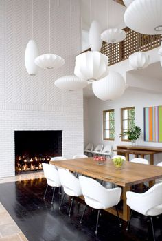 Mid-century lights and a herringbone fireplace. love it.