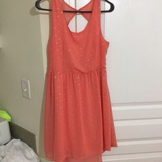 Coral with silver metallic polka dot dress! Never worn Francescas dress. It is pretty short so probably 5'8 and shorter. Pretty coral color with silver accents the back is open so you will probably need a strapless bra Francesca's Collections Dresses Mini