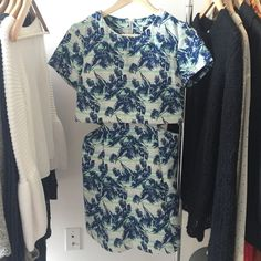 """Topshop Tropical Leaf Print Overlay Dress mini length fit & flare dress with an overlay top. fits true to size. this dress is quite short- I'm 5'3"""" and it's pretty mini on me. made of solid & slightly stretchy cotton/polyester/viscose blend. back zip closure. only worn twice. Topshop Dresses Mini"""