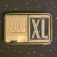 Belt buckle from decals on a 1960 Ford 500 XL.  Nice one.
