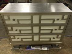 Our Chin Hua Collection Chest, 699-702-2, with a Silver Block Leaf exterior and White Pearl drawer fronts. Stunning.
