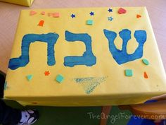 The Shabbat Box. Filled with items made/decorated by each child. Kiddish cup, kippa, challah cover