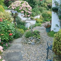 sloped garden & gravel path with stepping stones