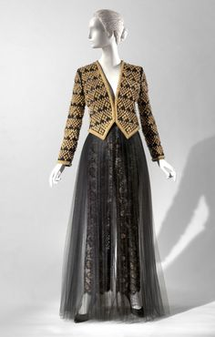Woman's Evening Ensemble: Jacket and Trousers Gold and Black Evening Jacket and Trousers  Designed by James Galanos, American, born 1924. Embroidered by D. Getson, Eastern Embroidery, Los Angeles.  Geography: Made in United States, North and Central America Date: Fall 1991