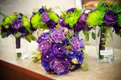 wedding decoration centerpieces with purple and green flowers