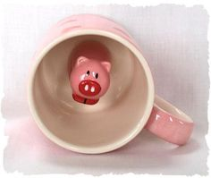 surprise mug. had something like this when i was a little kid! don't think it was a pig, tho