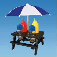NOVELTY CONDIMENT SET IN PICNIC TABLE WITH PARASOL , CAMPER, MOTORHOME.      This cute condiment set would adorn any table. It's got 4 holes to seat salt, pepper, mustard and a ketchup bottle. Ideal when entertaining the kids on a sunny day outside or when you're stuck inside all day (I'm thinking rain!).