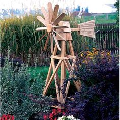 Wooden Lawn Furniture - it would be awesome if you could get a small, functional windmill to power something like your lights or a water feature pump? Diy Wood Projects, Outdoor Projects, Wood Crafts, Woodworking Projects, Outdoor Decor, Yard Windmill, Wooden Windmill, Yard Art, Lawn Furniture
