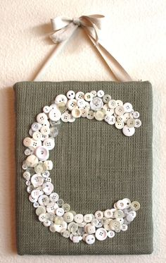 Burlap & Buttons Monogram, I can see this being really cute for my girls to do with the shells they collect from the beach since they allways get the tiny ones :-)