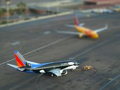 Seaworld Souvenir - McCarran Int'l Airport, NV  USA by gTarded, via Flickr / Shamu and New Mexico One on the ground in Vegas. Neat tiltshift action