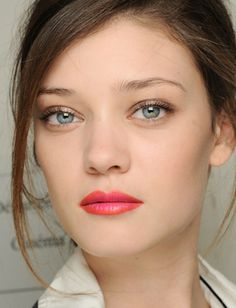 Orange lip liner with pink lipstick for a deconstructed coral lip that isn't too distractingly ombre, metallic taupe eyes