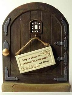 """Fairy Door- """"Any tree is converted into an enchanted abode for the little winged people who are believed to slumber by day and dance in the moonlight.  English Tudor styling has faux limestone threshold and hook for reversible sign.  Painted resin. 5 x 7"""". Reads:Shhh...the fairies are sleeping/Sorry we missed you, we're dancing in the garden."""" How fun for little ones!"""