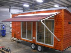 I had to show you this portable tiny home on wheels called the Elaine Cabin built by Rich Daniels of Rich's Portable Cabins. In the past I've shown you one of his park model tiny houses… Tiny House Layout, House Layouts, Tiny House Plans, Tiny House On Wheels, Little Houses, Tiny Houses, Small Cottages, Portable Cabins, Small Sheds